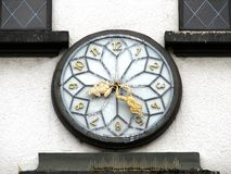 Vintage clock. With frog-shaped hands royalty free stock photography