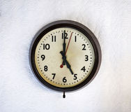 Vintage clock. Bakelite vintage clock on a white wall stock image