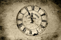 Vintage clock. An old station clock in sepia grunge Royalty Free Stock Image