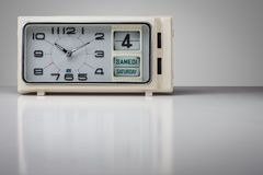 Vintage clock. With calendar on grey background Stock Photo