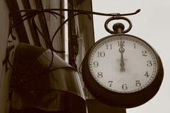 Vintage clock. Haning in Krakow- Poland royalty free stock photography