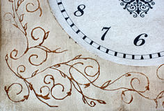 Vintage clock. With painted ornaments Stock Photo