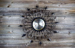 Vintage Clock on Aged Wood. Top view of old fan star shaped clock on rustic wood Stock Images
