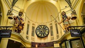 Vintage clock in an alley at shopping arcade. Melbourne gog at Bourke shopping arcade Stock Photos
