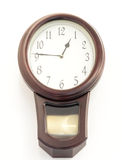 Vintage clock. Ancient vintage clock on white wall background Stock Images