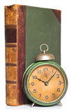 Vintage clock and antique book Stock Images
