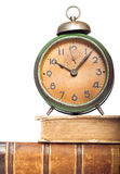Vintage clock on antique books. Isolated on white Stock Images