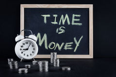 Vintage clock, blackboard and coin towers on black Stock Image