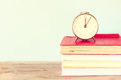 Vintage clock on books Stock Photo