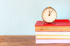 Vintage clock on books Stock Image