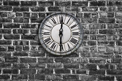 Vintage clock on a brick wall Stock Images