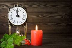 Vintage clock and candle Royalty Free Stock Images