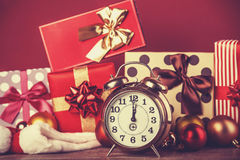 Vintage clock on christmas background. Stock Images