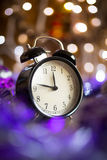 Vintage clock with Christmas lights Royalty Free Stock Photography