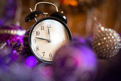 Vintage clock with Christmas lights Stock Image