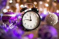 Vintage clock with Christmas lights Stock Photo