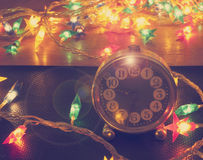 Vintage clock and Christmas lights Royalty Free Stock Image