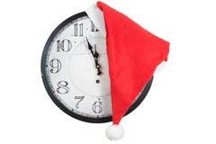 Vintage Clock with christmas santa hat Stock Photo