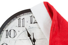 Vintage Clock with christmas santa hat Royalty Free Stock Images