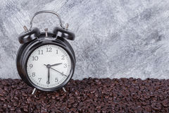 Vintage clock and coffee beans Coffee time concept with wall b Stock Images