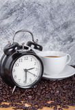 Vintage clock and coffee in cup Coffee time concept with wall Stock Photo
