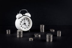 Vintage clock and coin towers on black Royalty Free Stock Image