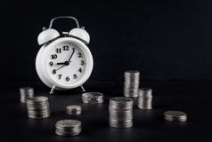 Vintage clock and coin towers on black Stock Images