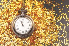 Vintage clock on confetti background stock images