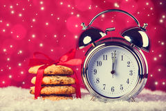 Vintage clock and cookies Stock Photography