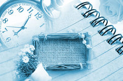 Vintage clock and diary with sack photo frame Stock Images
