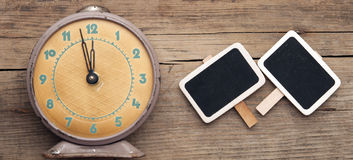 Vintage clock and empty chalkboard Royalty Free Stock Photo