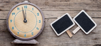 Vintage clock and empty chalkboard Royalty Free Stock Images