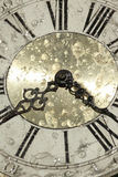 Vintage clock face. Decorative vintage clock framed with an iron radial structure Stock Photography