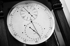 Vintage clock-face of ancient chronometer. Vintage clock-face, closeup black and white photo of ancient chronometer Royalty Free Stock Images