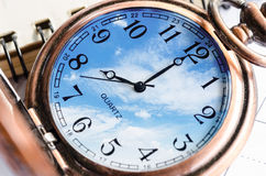 Vintage Clock face in blue sky Stock Photography