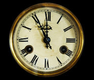 Vintage clock face, isolated on a black background. Stock Image