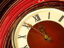 Vintage clock face taken closeup on twirl abstract background. Stock Photography