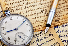 Vintage clock with fountain pen Stock Images