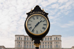 Vintage clock in front of Parliament, Bucharest Stock Images