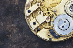 Vintage clock gears close-up, time mechanism. Vintage clock close-up, time mechanism with metal gears, business watch stock photography