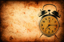 Vintage clock on Grunge old paper texture Stock Photography