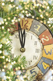 Vintage clock and holidays lights Royalty Free Stock Photography