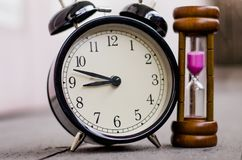 Vintage clock and hourglass or sand-glass for time management  concept Stock Photos
