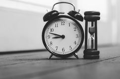Vintage clock and hourglass or sand-glass for time management Royalty Free Stock Image