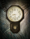 Vintage clock on jeans background Stock Photo
