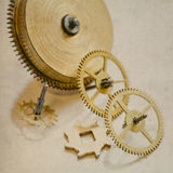 Vintage clock mechanism with gears. old paper background Royalty Free Stock Photo