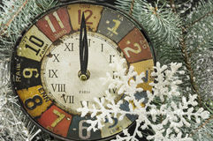 Vintage clock for New years eve and snowflakes Royalty Free Stock Photo