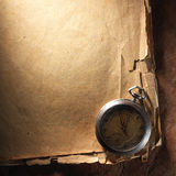 Vintage clock on old paper royalty free stock photography