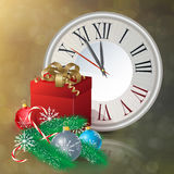 Vintage clock over snowfall christmas background. Stock Photo