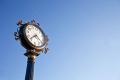 Vintage clock post. With blue sky Royalty Free Stock Images